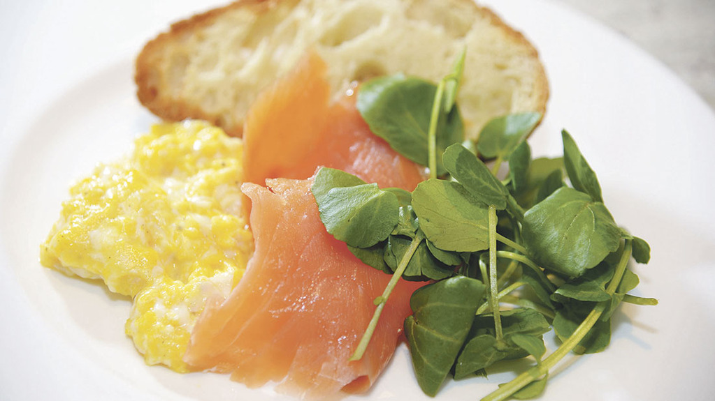 Scrambled eggs with salmon and watercress