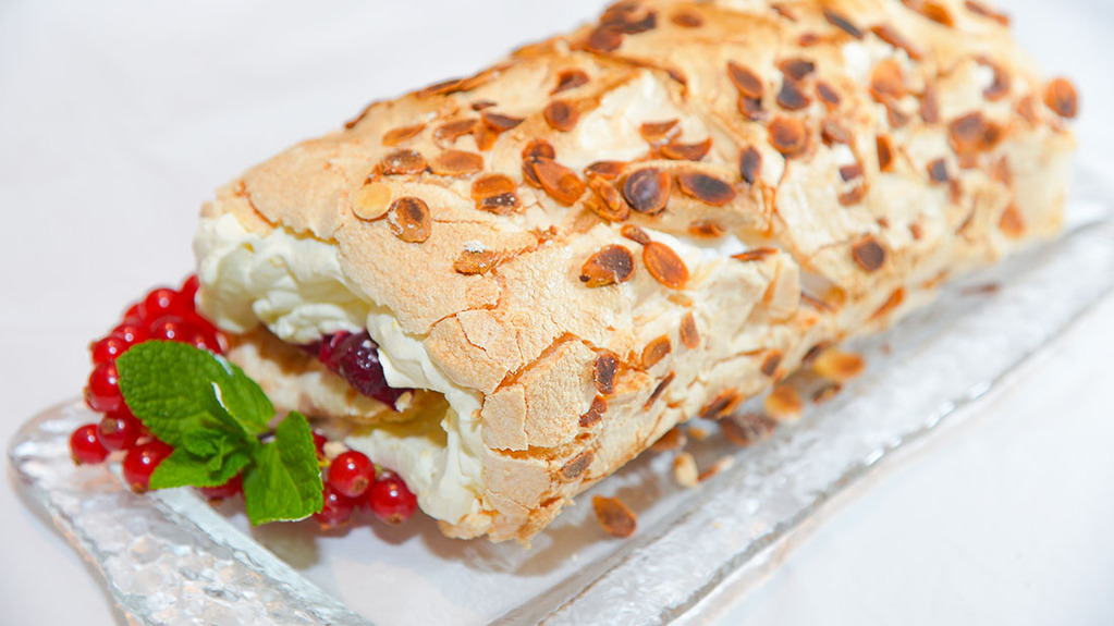Cranberry and orange meringue roulade