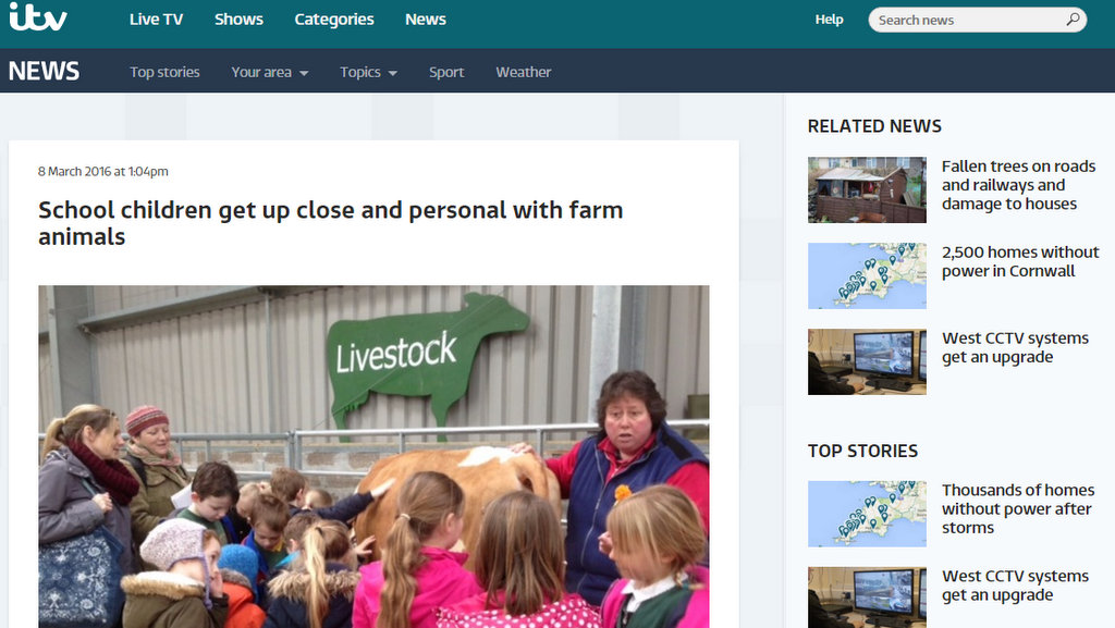 School children get up close and personal with farm animals