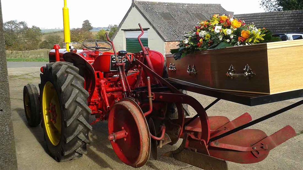 Farmer carried to funeral on tractor and plough