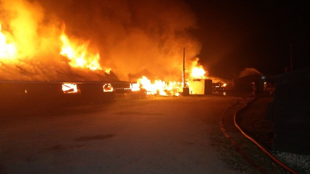 Firefighters tackle huge fire on livestock farm