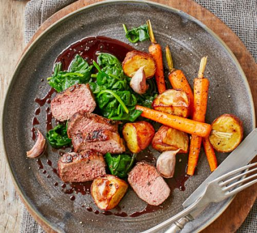 Loin of lamb, wilted spinach, carrots and rosemary potatoes