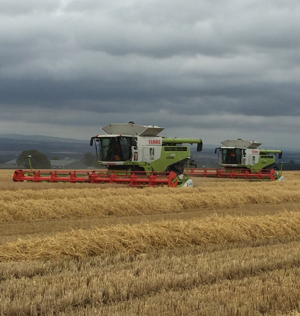 Two combines trying to beat the rain in Scotland