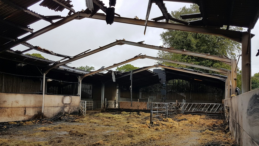 Farmers warned by police as barn set on fire and bales slashed