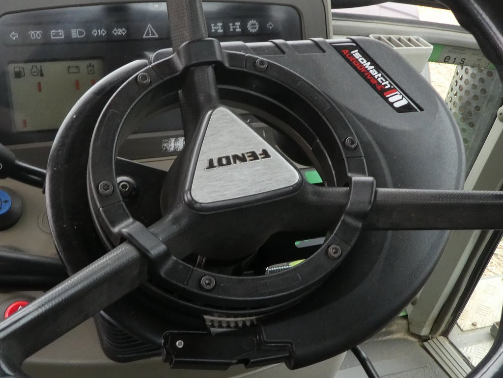 The firm's Auto Drive-E uses a gear-ring to mount to the tractor's standard steering column.