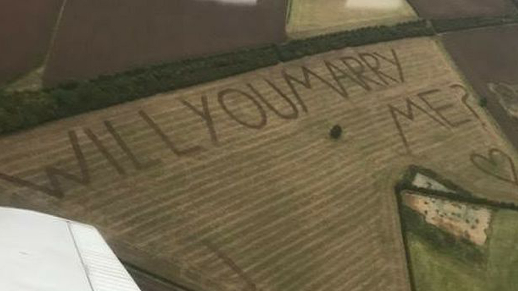 "Farmer flies partner over huge ""marry me"" proposal in field"