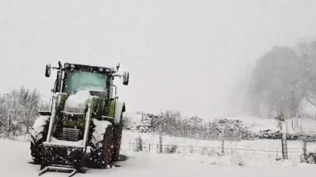 VIDEO: Heavy rainfall causes widespread UK flooding as snow falls on Scottish farms