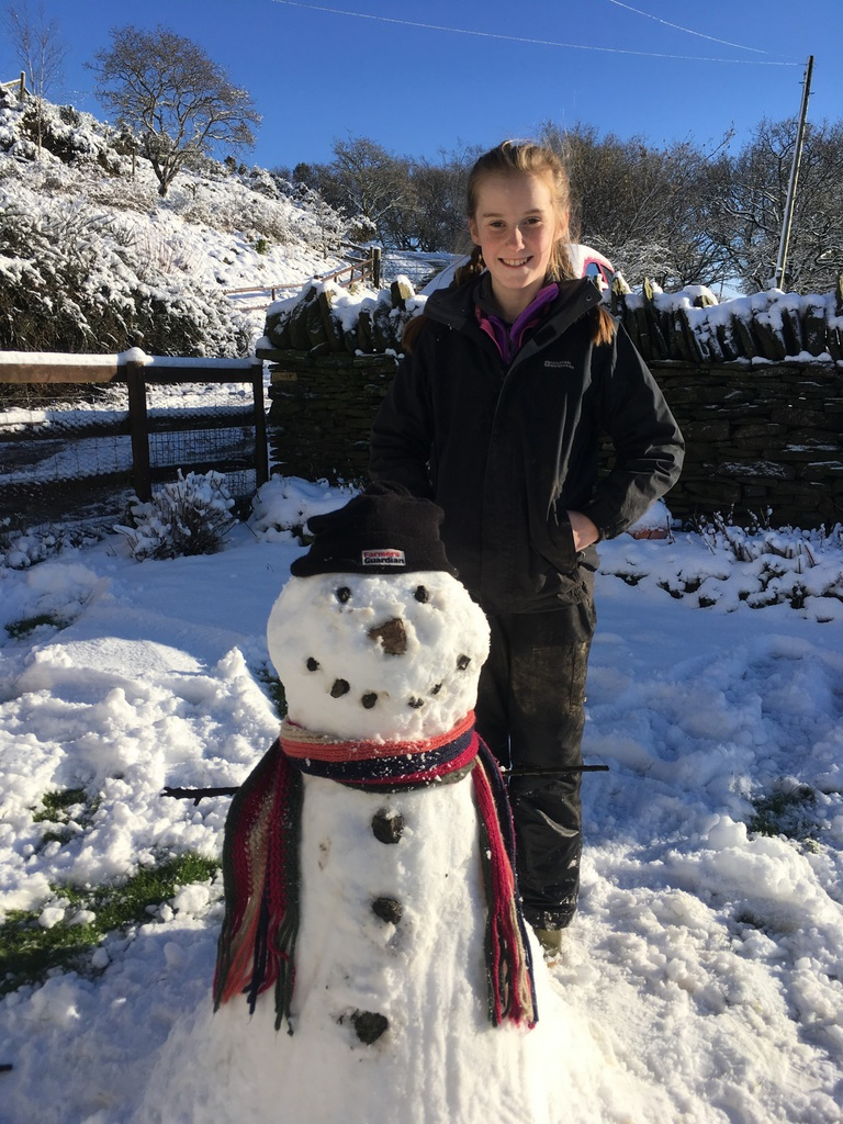 Can't beat a farmers guardian hat! My sister Rhianne Huntley with her snowman in Pontypridd