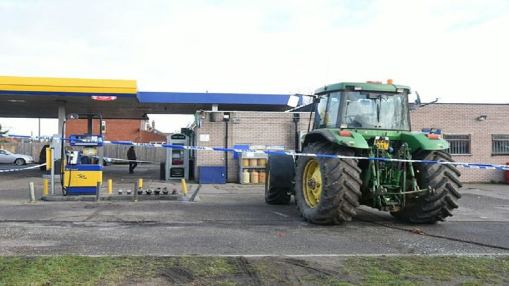 Stolen tractor used to ram raid cash machine at petrol station
