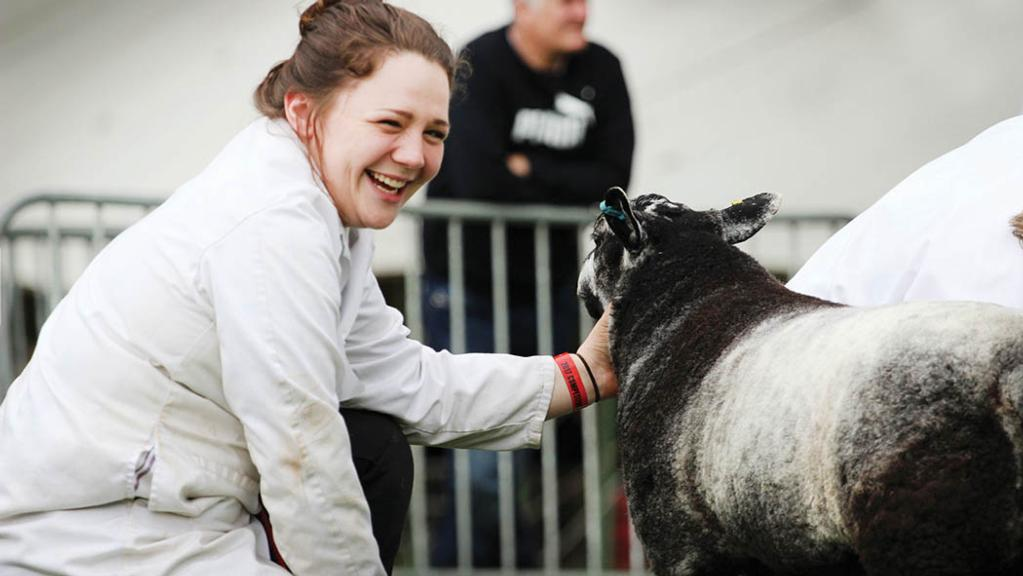 Young livestock fanatic relishes in the farming community she grew up in