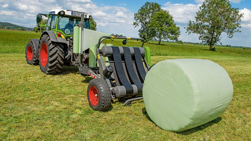 Fendt Rollector 130 round bale wrapper.
