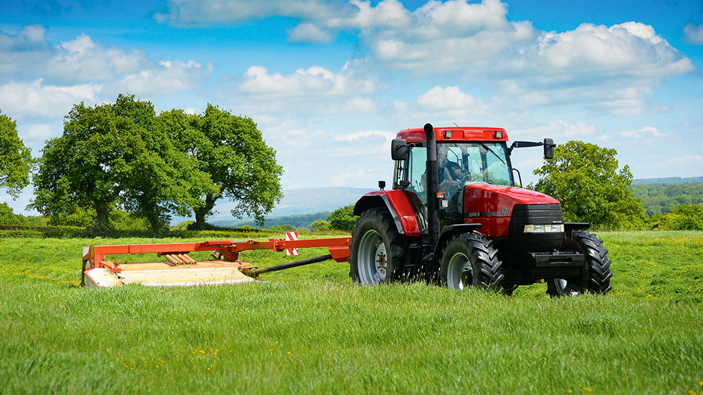 The Coars' MX120 still earns its keep mowing.