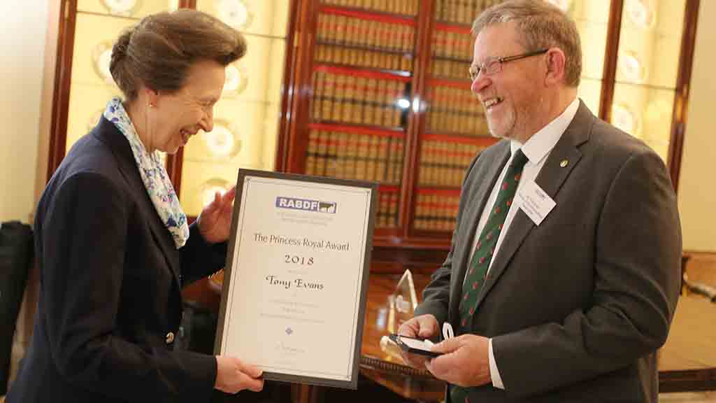 Princess Anne presents the award to Tony Evans