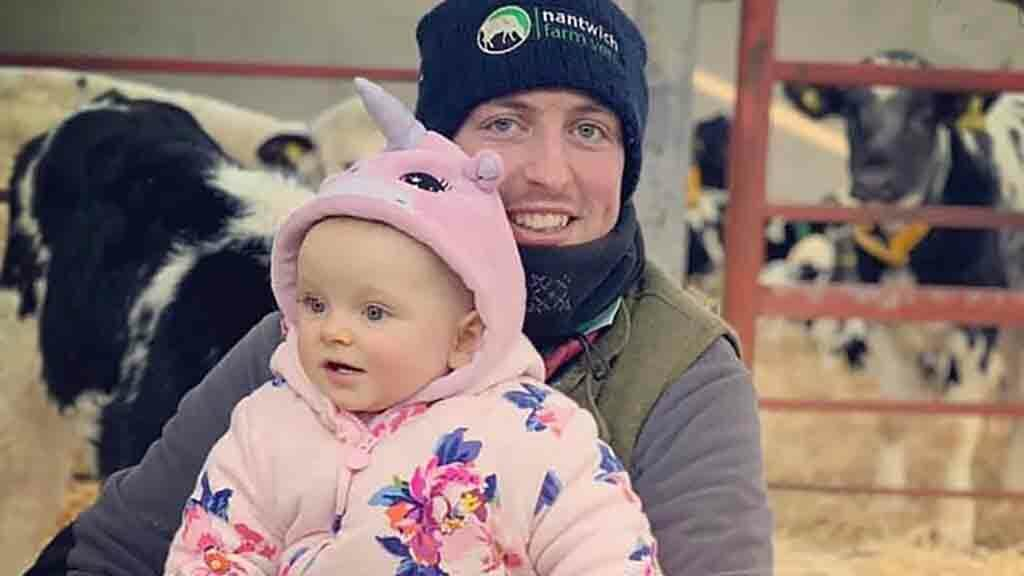 Ben Paterson and his daughter on the farm