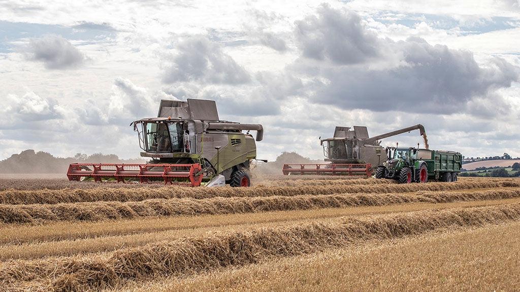 Contract farming business swaps large combine for pair of smaller models