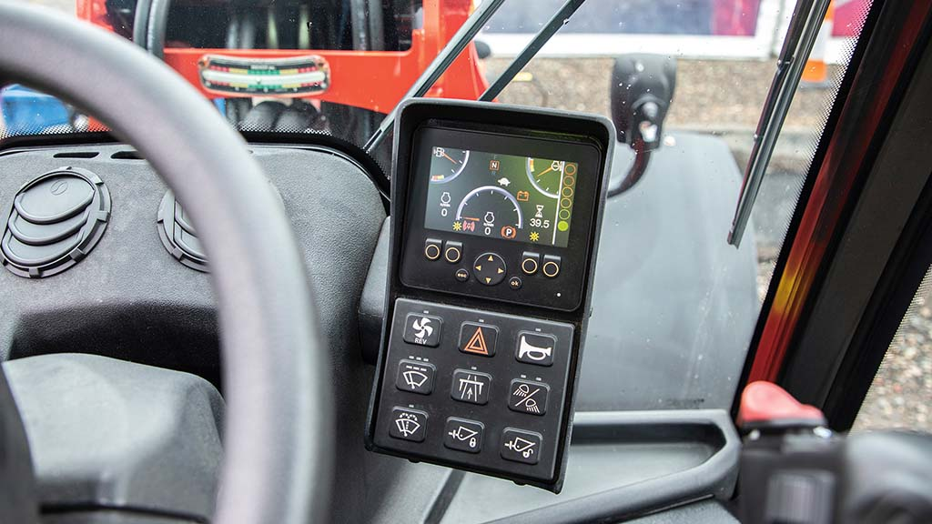 Instrument panel is combined with a switch-pad for easy access to machine functions.