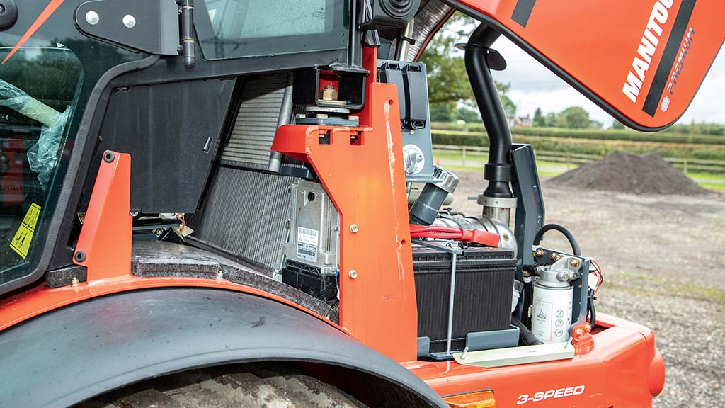 Engine compartment offers easy access for daily checks.
