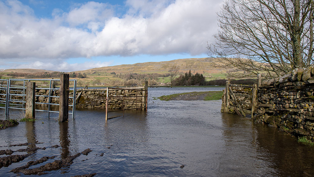 Threat of 'significant flooding' in north as heavy rainfall continues to batter UK farms