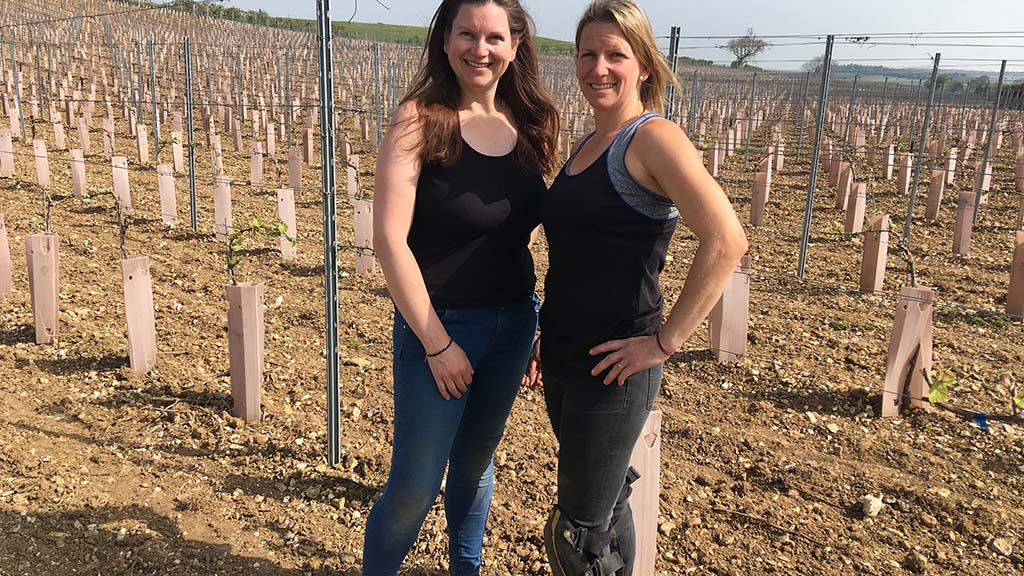 Samantha and Laura in front of their newly planted vineyard