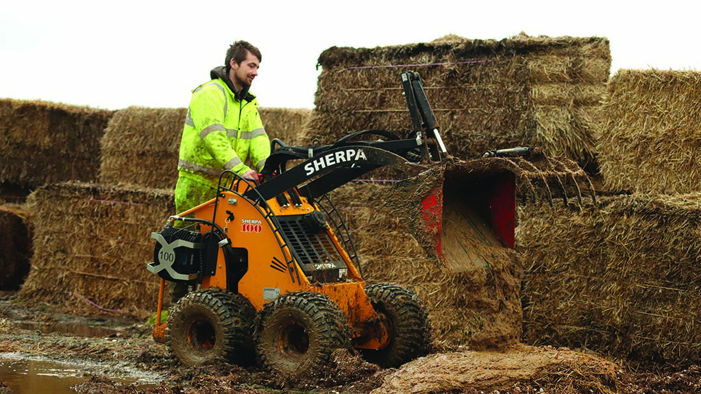 Small stand-on skid steer loader saves time