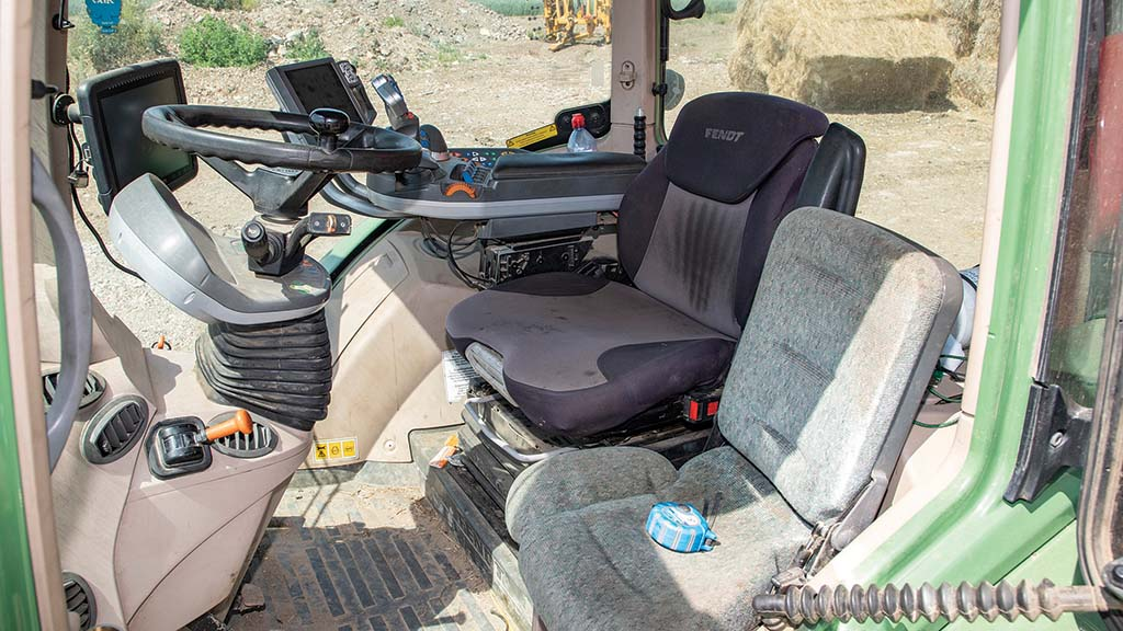 The cab interior is wearing well on this eight-year old, 8,000 hour Fendt 724.