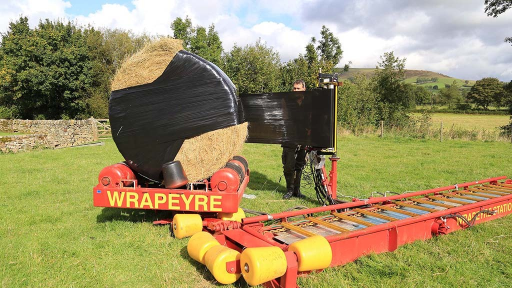 Serial inventor Geoff Eyre has designed and built a wrapping system to speed up the process and reduce handling.