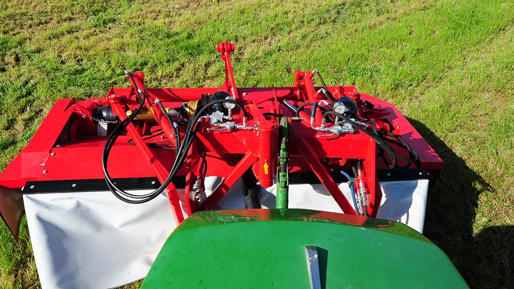 The steerable mower swings through a 16 degree arc and needs a double acting spool for control.