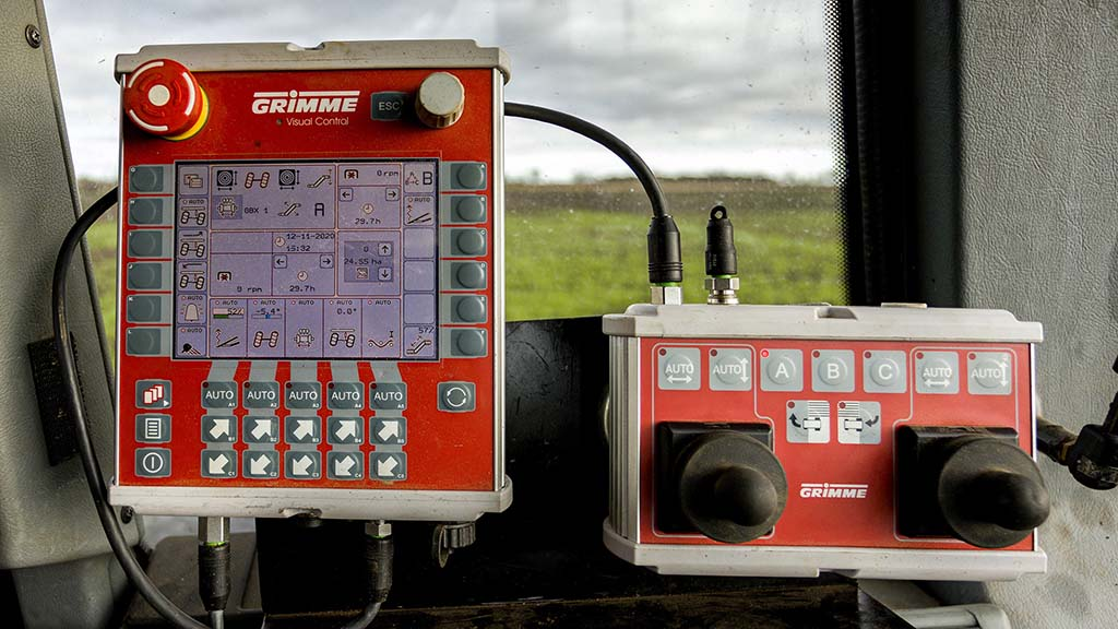 Windrower controls have been integrated into the Grimme control box, with the exception of a diverter valve.