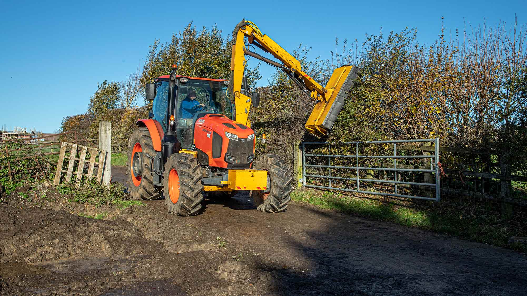 A Kubota MG125X-IV has proved a capable host tractor for Alban Turney's mid-mount hedgecutter.