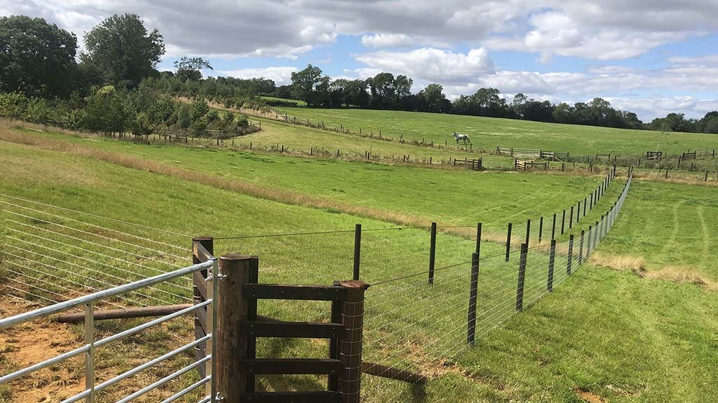 Stock fencing with two lines providing a barrier to prevent animals getting too close to each other; electrification prevents stock from leaning on fences and prolongs their life.