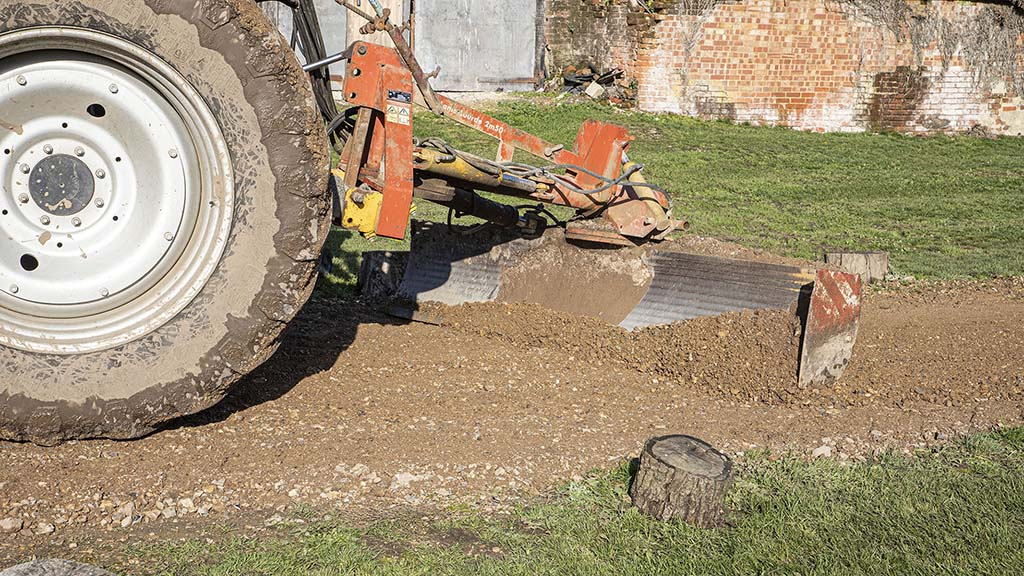Grading also allows a camber to be applied to the surface, to improve run-off.
