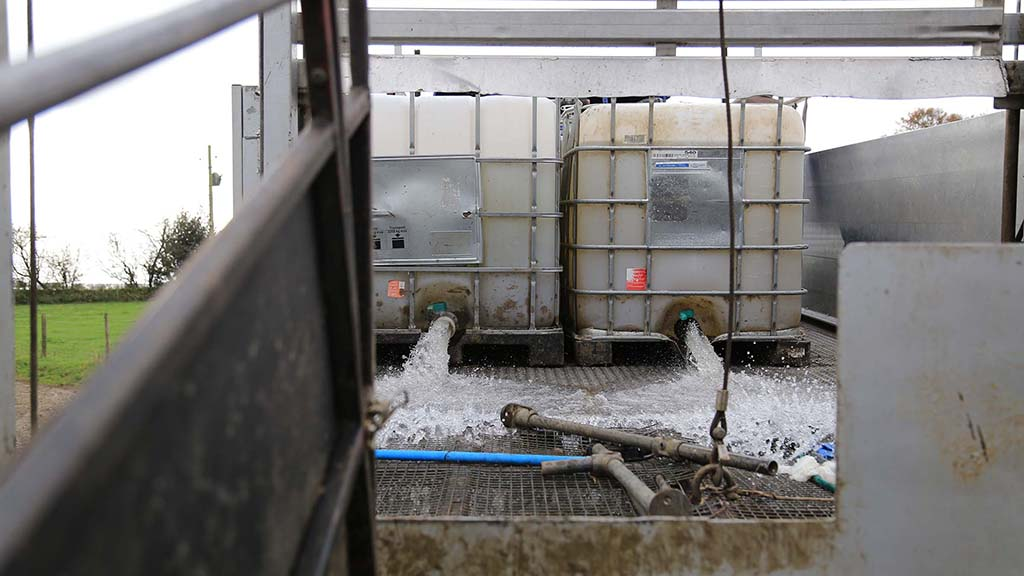 The lorry carries four IBCs that transport clean water to and used water away from the farm.