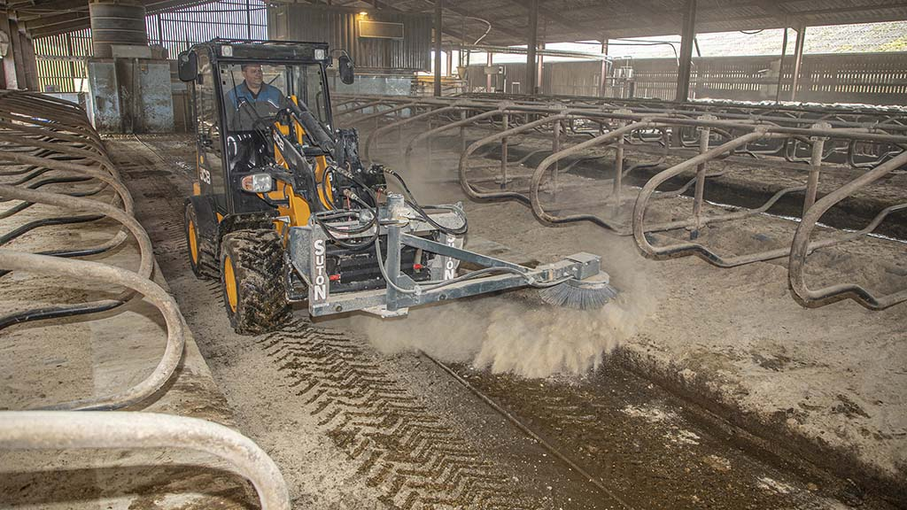 Hydraulic brush has shortened clean-up times in cubicles.