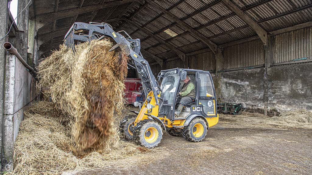 Muck grab attachment proves handy when cleaning out calf pens.
