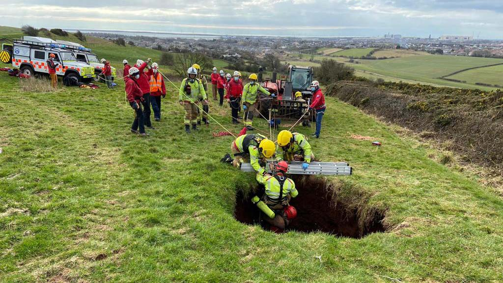 60ft sink-hole 'swallows' farmer riding quad bike