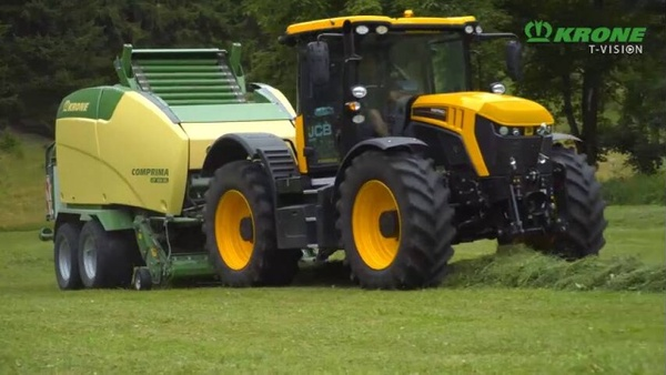 Krone Comprima round baler in action