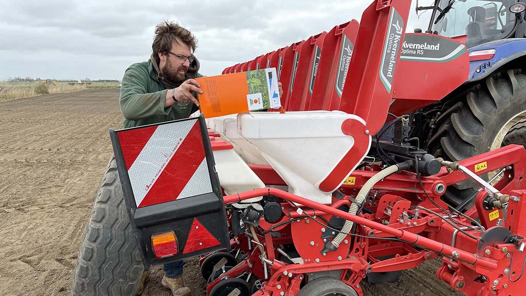 Jordan Abblitt fills the seed hoppers; microgranule hoppers sit behind and are used for placement nitrogen fertiliser, reducing the number of passes needed and improving nutrient efficiency which has allowed rates to be cut.