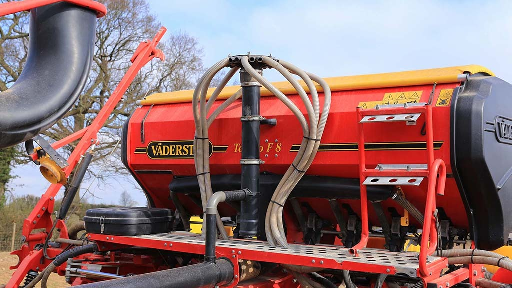 Because the fan is larger than needed for the eight row planter, excess air is syphoned off and used to blow the grass seed to the rear of the planter.