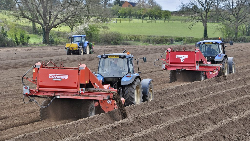 Pictured while potato planting, Staffordshire farmer Colin Smith and his father Richard rely on a fleet of 12 nouveau-classic Ford and New Holland tractors spanning 30-years of tractor production.
