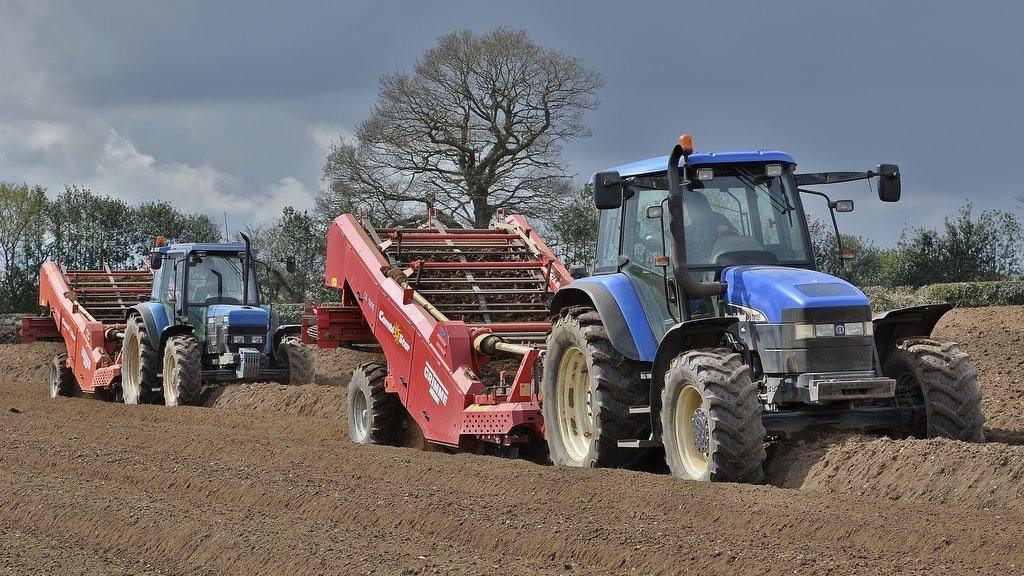 This New Holland TM155 and Ford/New Holland 8340 SLE are pictured de-stoning in preparation for potato planting. Between them, the two tractors have clocked more than 26,200 hours.