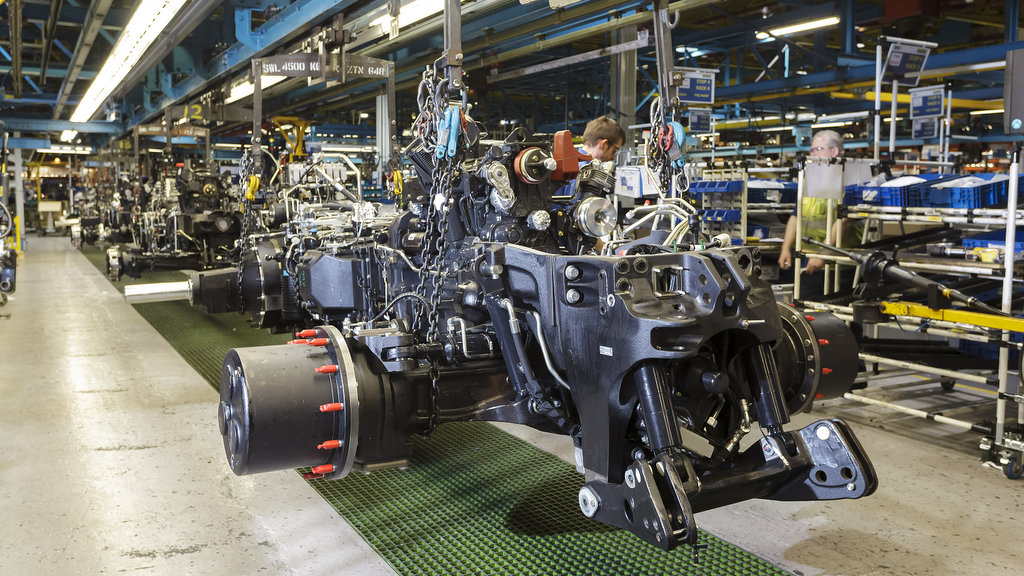 What disruptions has Covid-19 brought to New Holland, particularly manufacturing and distribution?