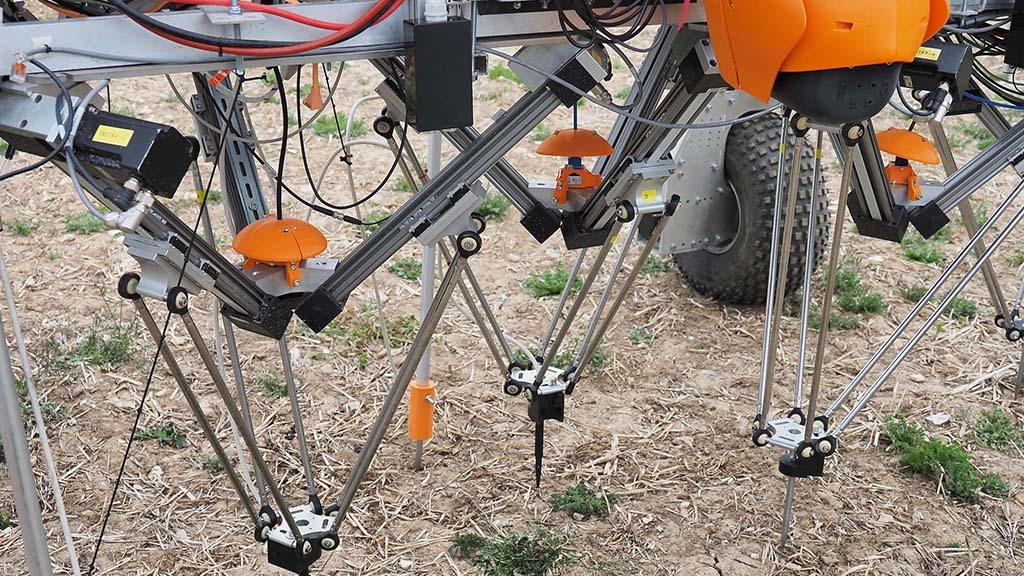 New partner Igus has developed a delta robot arm to position the probes; they are placed according to images from a camera (under the orange ball-shaped cover) which locates weeds identified by Tom and the Wilma AI platform.