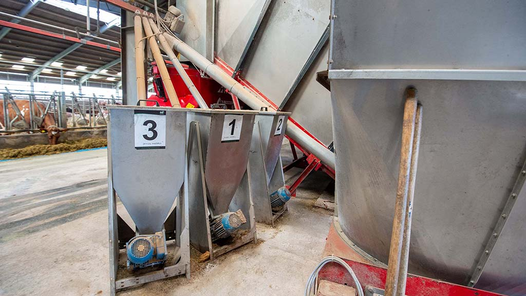 Smaller bins and an auger add minerals to the ration.