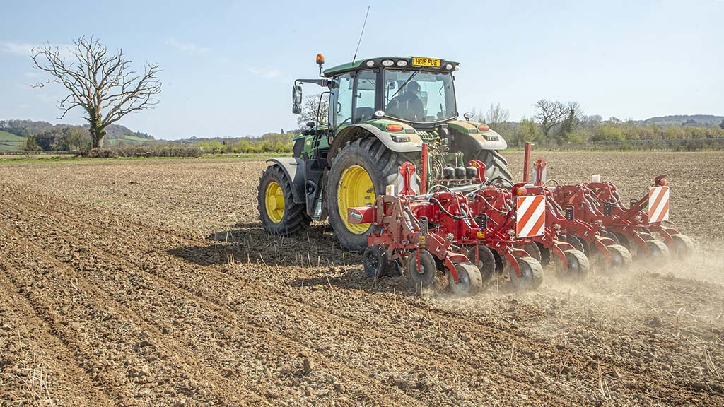 Leaving strips of ground untouched helps maintain a firm surface for the forager and trailers to run on, during maize harvest.