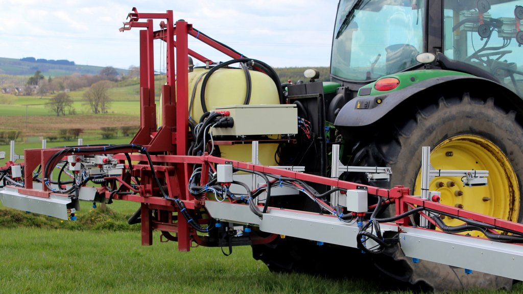 To overcome line pressure differentiations as the nozzles continually open and close, the modified sprayer boom features recirculation systems on all three boom sections.
