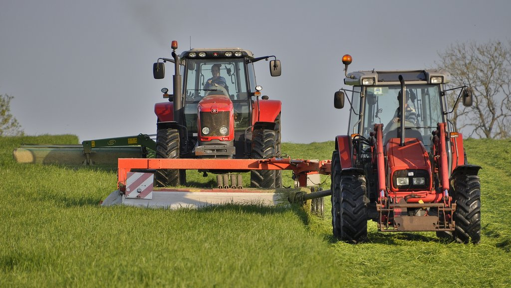 The high-visibility MF 4255 and 4355 are described by Andrew Rees as absolutely bullet-proof and have given very little trouble. This image shows the MF 4255 and MF 6840 mowing grass for silage.