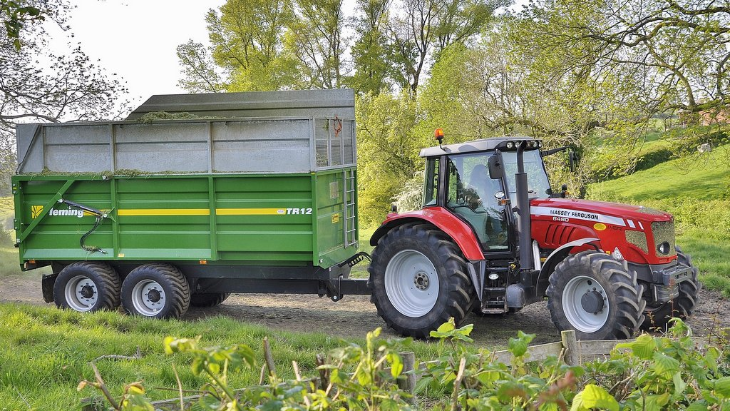 The venerable and popular MF 6480 Dyna-6 remains a go-to choice for many MF customers. This example pictured carting silage with a Fleming TR12 trailer is one of two used by the Rees family.